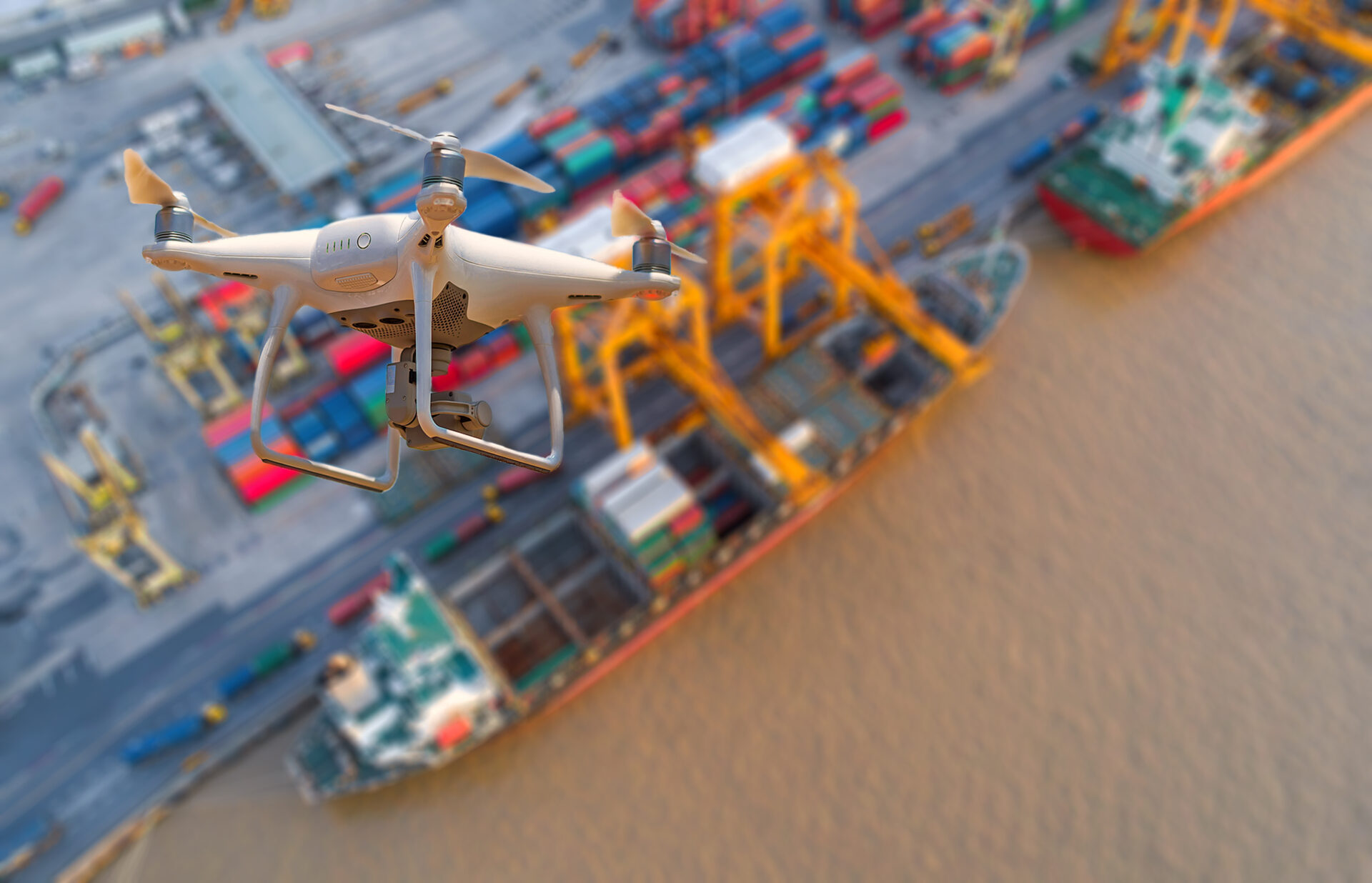 Drone flying over container ship in import export and business